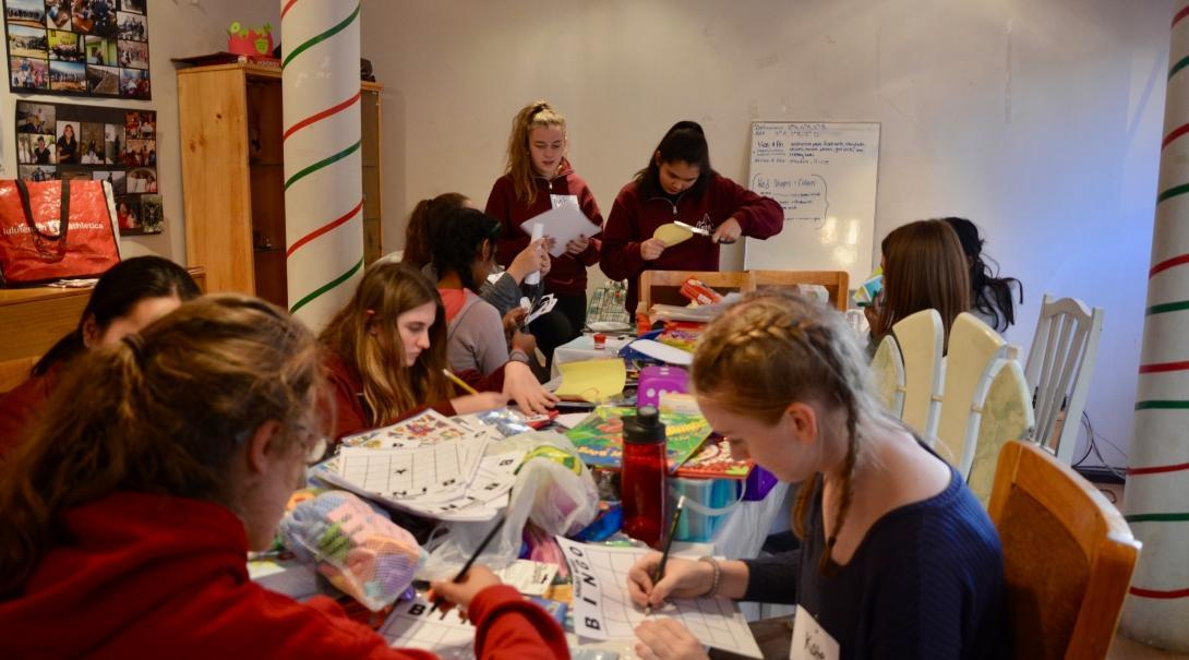 Projects Abroad volunteers work together to create educational materials to help young children learn in Peru.